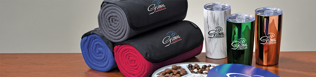 Business Gifts that include blankets, coffee tumblers and assorted chocolates