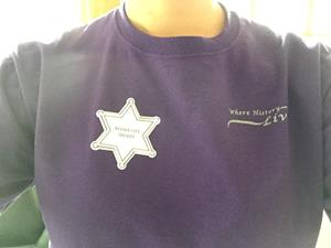 Customer image from Kate of our Lapel Sticker by the Roll - Sheriff Badge